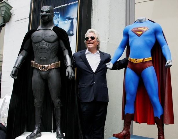 450823-film-producer-jon-peters-poses-with-a-batman-left-and-superman-right-c